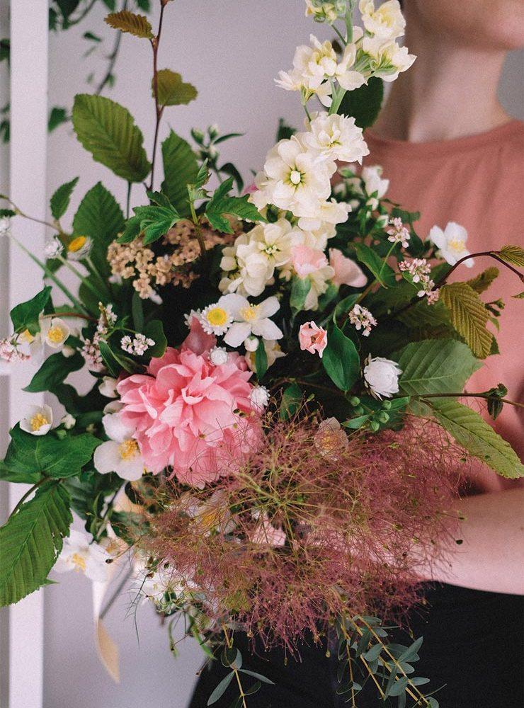 florist holding bouquet